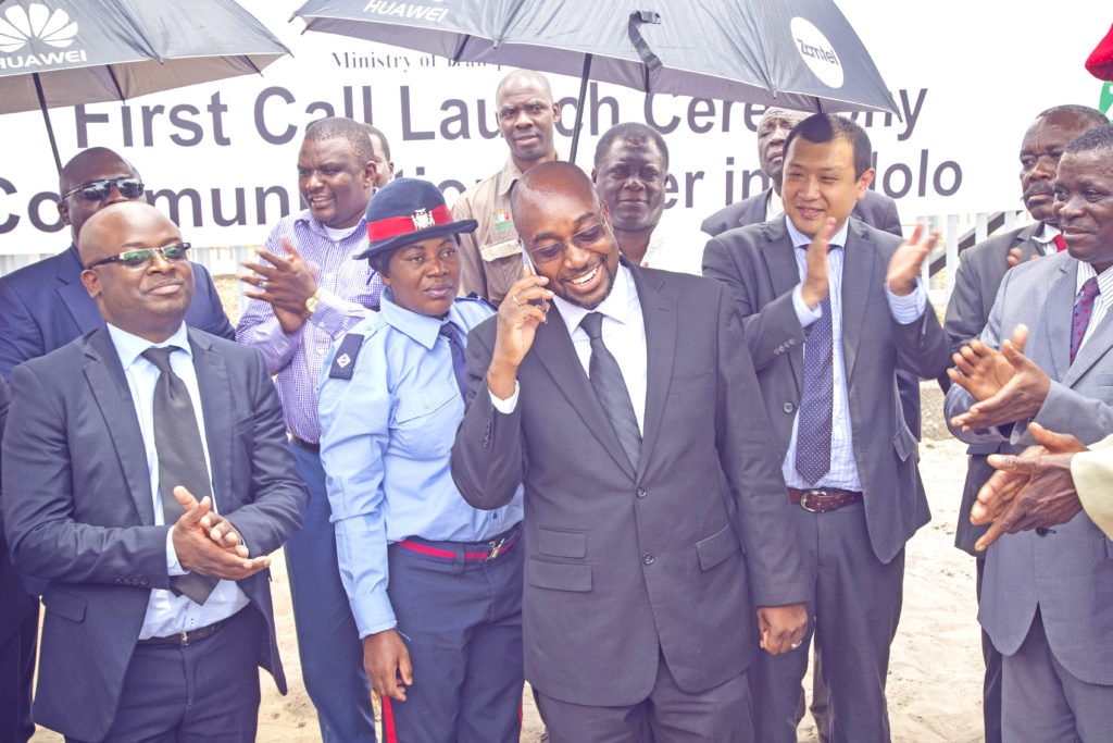 Minister of Transport and Communications Hon. Brian Mushimba makes the first call to launch the second phase of the Universal Access Programme, paving the way for every citizen in the country to have access to a mobile phone signal.