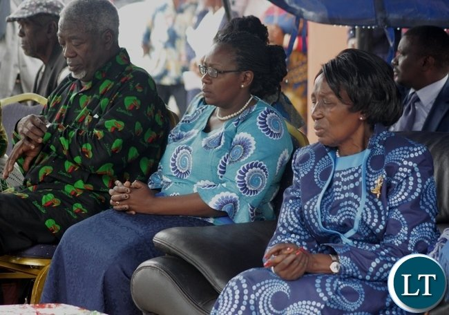 Vice President Inonge Mutukwa Wina (r) with her daughter Mutende Wina (c) and her young brother Dr. Kasuka Mutukwa (l) following the procession during the memorial service of the Vice President's father the late Mr. Simwinji Mutukwa in Sibumbu Village in Nalolo District, Western Province