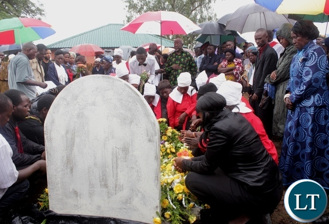 United Church of Zambia (UCZ) members laying wreaths on the Vice President Inonge Mutukwa Wina's late father's gravesite Mr. Simwinji Mutukwa during the memorial service in Sibumbu Village in Nalolo District, Western Province