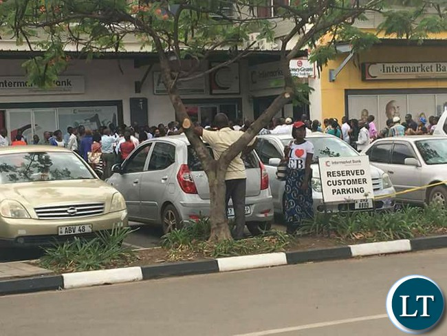 Customers line up outside Intermarket banking corporation branch at Farmers house