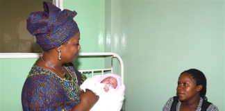 First Lady Esther Lungu(r) congratulates the Mother of the Christmas baby at University Teaching Hospital in Lusaka