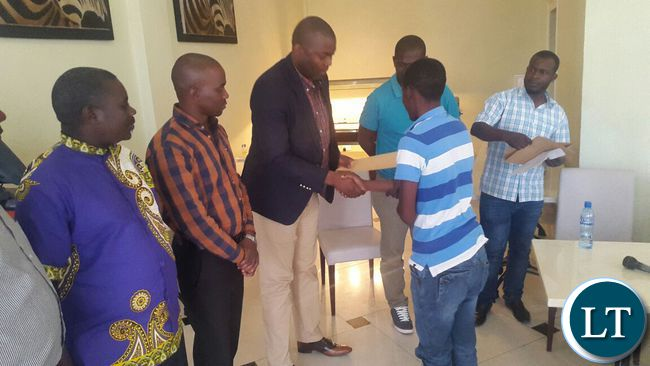 handing-over-scholarship-to-charles-tembo-1