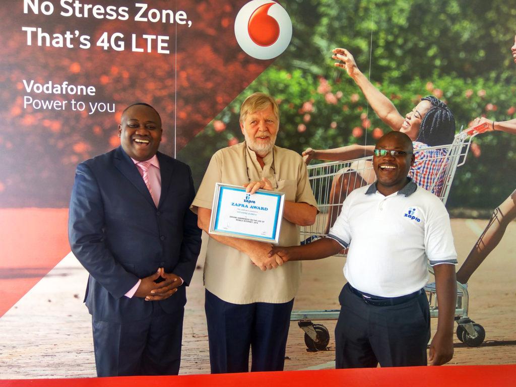 Vodafone Zambia CEO, Lars Stork (C) receives President's Award from Zambia Public Relations Association (ZAPRA) President, Mr. Davies Mupenda (R) and Vice President Masuzyo Ndhlovu  (L)