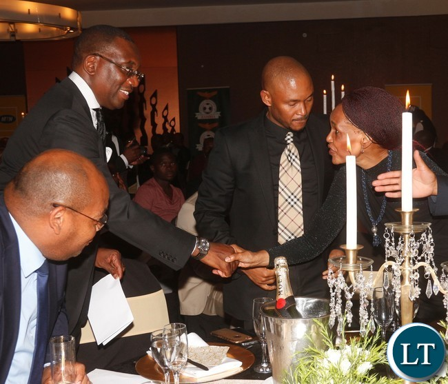 FAZ President Andrew Kamanga shaking hands with South Africa High Commissioner to Zambia Sikose  Mji while looking on is MTN - Zambia CEO Charles Molapisi.