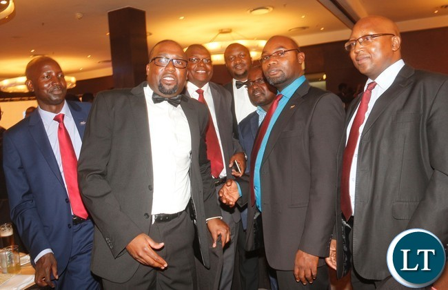 Minister of Youth, Sport and Child Development Moses Mawere with Zanaco FC officials.?