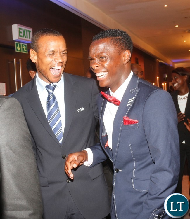 FIFA Referee Janny Sikawe cracking a joke with Patson Daka.
