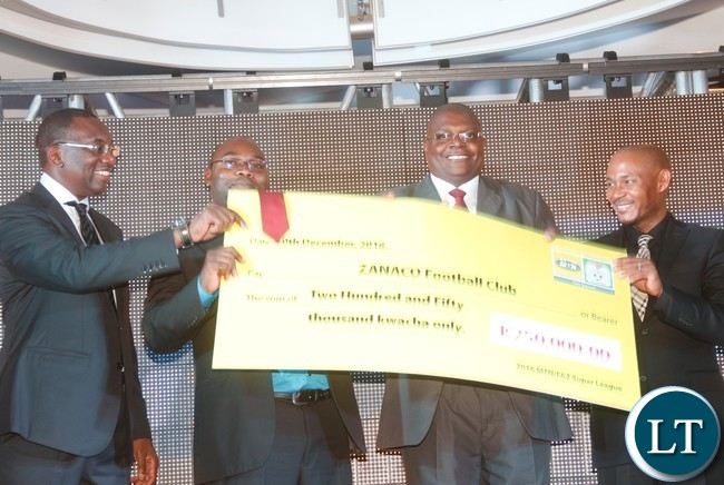 """AZ President Andrew Kamanga., Minister of Youth, Sport and Child Development Moses Mawere, ZANACO FC acting Club Chairman Jordan Maliti and  MTN - Zambia CEO Charles Molapisi during a presentation of a cheque prize to the """" 2016FAZ/ MTN Super league"""" team champion."""