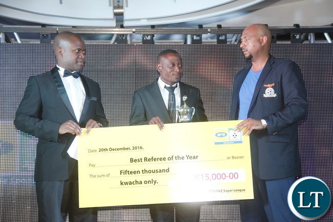 """MTN Zambia Head of Risk Management Kalunga Kanyanta, Kabwe based FIFA REferee Wisdom Chewe and FAZ Excom Lee Kawanu during a cheque prize presentation  of the """"2016 FAZ/MTN league best assistant referee of the year """" to the winner."""
