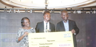 "MTN Zambia General Manager and Human Resources Ompie Shandavu, ZESCO striker Walter Bwalya and FAZ Treasurer Rix Mweemba during a a cheque prize presentation of the ""2016 FAZ/MTN league Top Scorer "" to the winner."