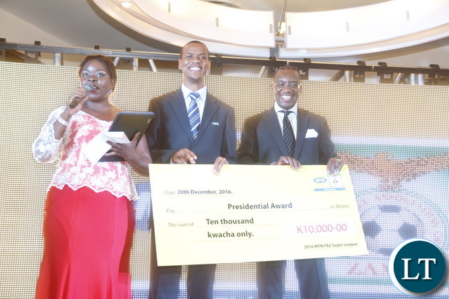 "ZNBC Sport presenter Maria Banda, FIFA referee Janny Sikazwe , FAZ President Andrew Kamanaga during  a cheque presentation to the ""2016 FAZ/MTN league  Presidential Award"" recipient."