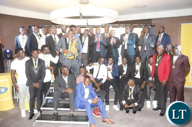 The 2016 MTN/ FAZ  Champions ZANACO FC posing for a picture with Minister Moses Mawere.