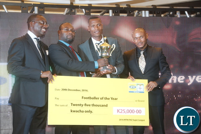 """FAZ President Andrew Kamanga., Minister of Youth, Sport and Child Development Moses Mawere, ZANACO FC team captain  Ziyo Tembo and  MTN - Zambia CEO Charles Molapisi during a presentation of a trophy  to the """" 2016 FAZ/ MTN Super league Year""""  winner."""