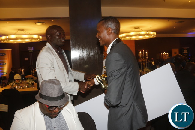 National team coach Wedson Nyirenda congratulating Ziyo Tembo.
