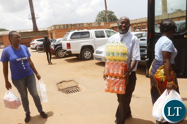 St Ignatius Paris Priest Fr Charles Chilinda carrying some drinks meant for UTH patients.-Jean Mandela