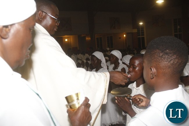 Roma Catholic Kabwata Parish Fr Vitalis Owino baptised some 100 youths and offered the 1st communion