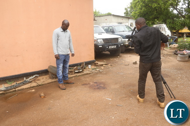 Visiting of the crime scene by ZNBC news crew.