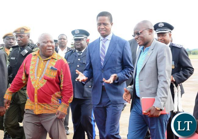 President Edgar Lungu speaks with his Specail Assistnace for Press and Public Relatuions Amos Chand flanked by Presidential Affairs Minister Freedom Sikazwe shortly after his arrival from Ghana yesterday 08-01-2016. Picture by Ennie Kishiki/ZANIS
