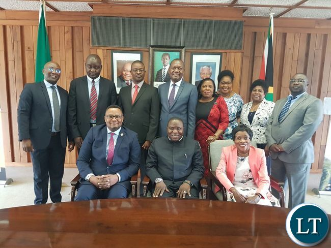 Foreign Affairs Minister Harry Kalaba poses for a photo with staff at the Zambian mission in Pretoria, South Africa
