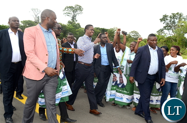 President Lungu flashes the PF symbol at Chipata  Compound Clinic where the First Family presented New Year gifts to Babies in Lusaka on January 1,2017 -Pictures by THOMAS NSAMA