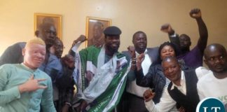 Pilato being embraced by PF members