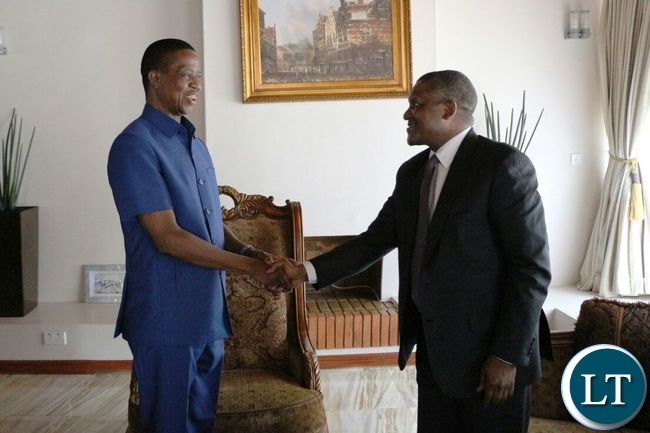 President Edgar Lungu with Nigerian tycoon Aliko Dangote at State House
