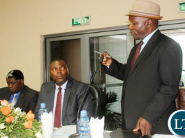Senior Chief Chiwala stresses a point as Copperbelt Minister Bowman Lusambo looks on