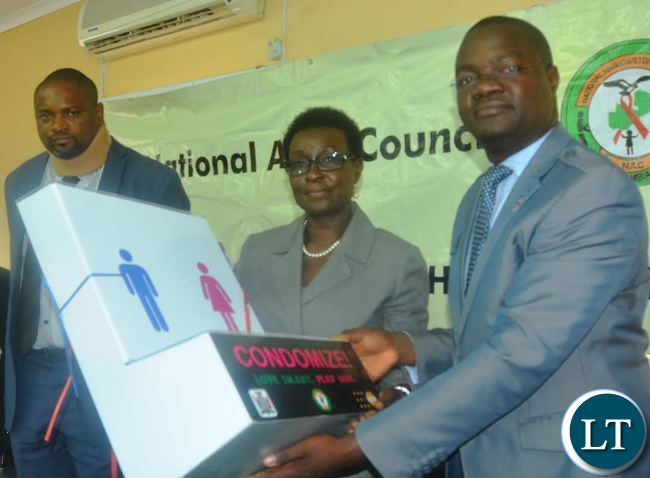 United Nation Fund for Population Actives (UNFPA)Country Director Mary Otieno handover Condom Dispensers to National Aids Council Acting Director John Mwale at National Aids Council offices
