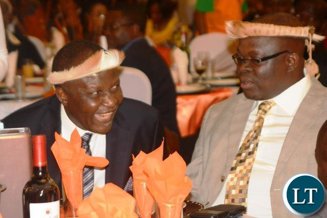 Finance Minister Felix Mutati(l) confers with Chief Madzimawe(r) during the Ngoni Cultural Night and Dinner Dance at New Government Complex