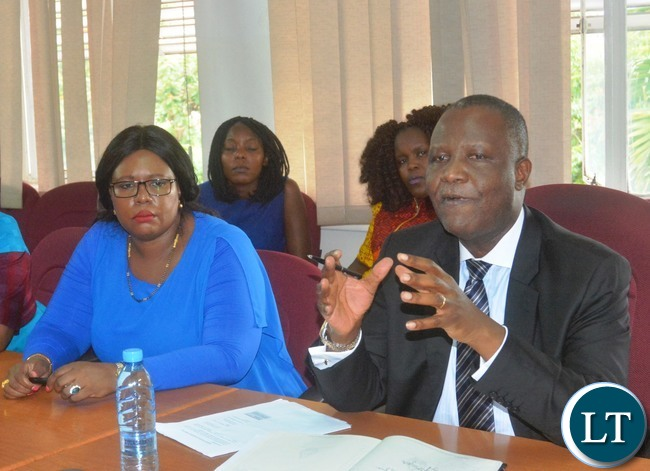 Minister of Finance Felix Mutati(r) stresses out a point while Agriculture Minister Dora Siliya(l) listens attentively during a Press Briefing at the Ministry of Finance