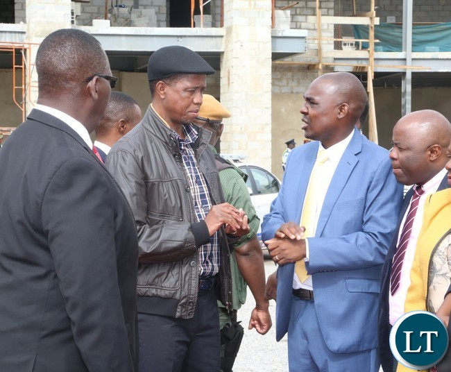 Lusaka Province Minister Japhet  Mwakalombe speaking to President Edgar Lungu at city airport shortly before the Presidents departure for North Western Province
