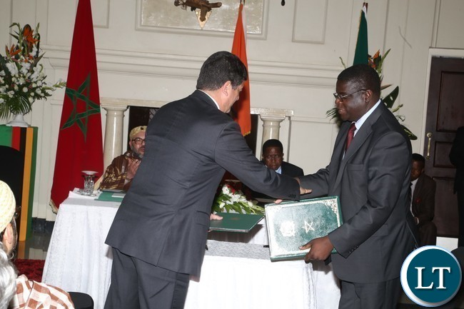 ZESCO Director Generation Fidelis Mubian and his Moroccan President of MASEN Mustapha Bakkoury exchange agreements on ZESCO and MASEN on renewable energy projects at State House