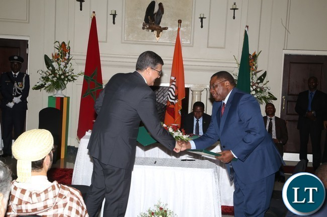 ZDA Director General Patrick Chisanga and his Moroccan counterpart President of the board Tanger Med Special Agencyexchange Documents of  MOU between ZDA and Tanger Med Special Agency  at State House