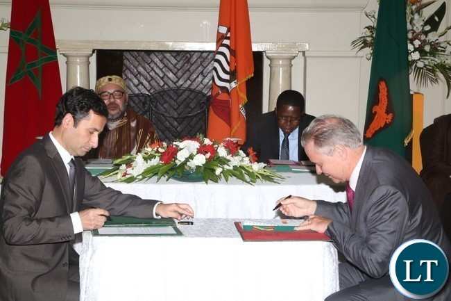 CEO of ZANACO Henk Mulder and his Moroccan CEO of attijariwafa Bank signs MOU between ZANACO and Attijariwafa Bank  at State House