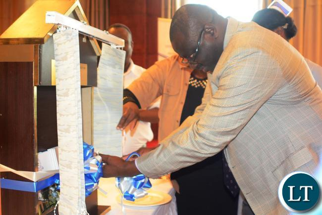 Ministry of Health Permanent Secretary Dr. Jabbin Mulwanda cuts the ribbon to officially launch the 2016-2020 Strategic Plan, This was during the official launch of the General Nursing Council Strategic Plan yesterday at Golden Peacock Hotel in Lusaka.