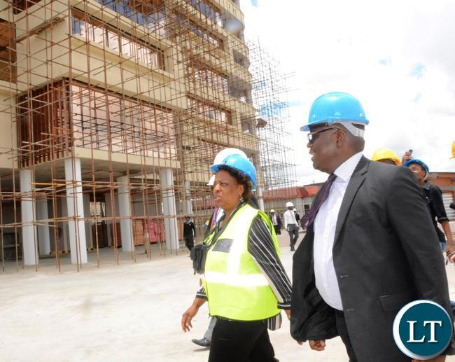 Minister of Labour Joyce Simukoko (in yellow reflector) flanked by Zambia National building Society Managing Director Joseph Chikolwa (r) touring the construction site of office at Society Business Park  in Lusaka