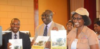 Ministry of Health Permanent Secretary Dr. Jabbin Mulwanda(c),General Nursing Council President Dr. Lonia Mwape(r) and General Nursing Council Registrar Aaron Banda(l) showcasing the 2016-2020 Strategic Plan during the official launch of the General Nursing Council Strategic Plan