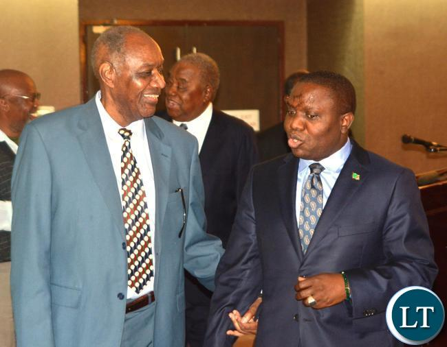 Foreign Affairs Minister Harry Kalaba(r) and Former foreign Affairs Minister Venon Mwanga(l) during the working breakfast with Former Foreign Affairs Ministers