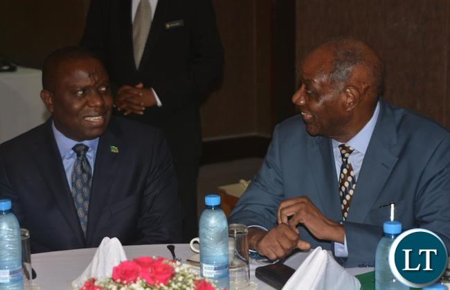 Foreign Affairs Minister Harry Kalaba(r) and Former foreign Affairs Minister Venon Mwanga(l) having a chat during the working breakfast with Former Foreign Affairs Ministers