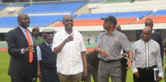 Ministry of Housing and Infrastructure Development Structural Engineer Francis Mundanya(l) explaining to the Minister of Works and Supply Mathew Nkhuwa(c) and Lusaka Province Minister Japhen Mwakalombe(r) the Development of the works during the tour of the Infrastructure at Heroes Stadium