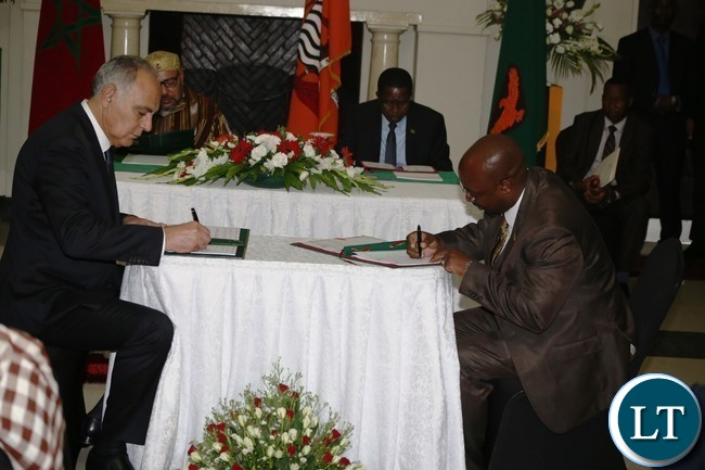Minister of Transport and Communication Brian Mushimba and his Moroccan  counterpart Minister of Foreign Affairs Salaheddine Mezouar signs agreement  on Air services at State House