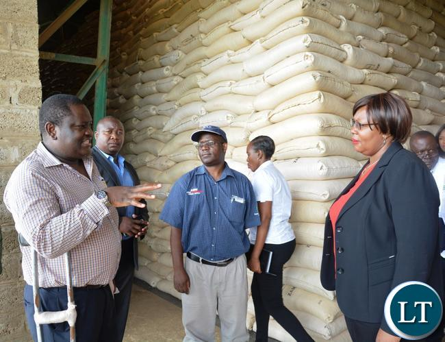 Food Reserve Agency Executive Director Chola Kafwabulula(l) explaining to the Minister of Agriculture Dora Silaya(r) as she toured the Food Reserve Agency
