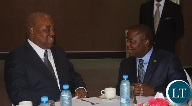 Foreign Affairs Minister Harry Kalaba(r) confers with the Forth Republican President Rupiya Banda(l) during the working breakfast with Former Foreign Affairs Ministers