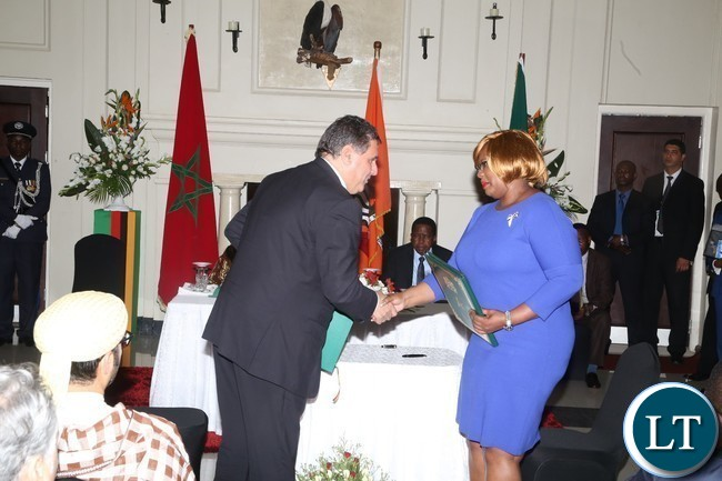 Minister of Agriculture Dora Siliya and her Moroccan counterpart Minister of Aziz Akhannouch shake hands after signs MOU in the Agriculture  sector at State House