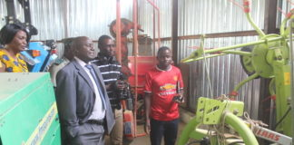 Southern Province Minister Dr Edify Hamukale admires equipment acquired by Monze Dairy Farmers Cooperative Society with donor support from Czech Republic and Netherlands Development Organisation (SNV) during his tour of the Milk collection Centre