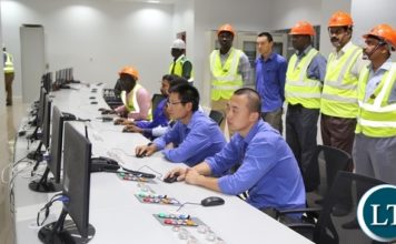 Maamba collieries thermal power plant engineers captured busy working in the 300 mega watts power plant.