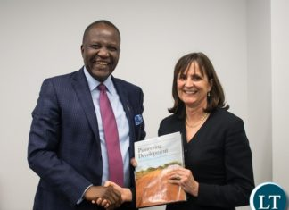 Hon. Felix Mutati with CDC chief executive officer Diana Noble after having a successful meeting.