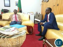 Kitwe Mayor Christopher Kangombe discussing with his Lusaka counterpart Wilson Kalumba at the Mayoral office in Lusaka recently
