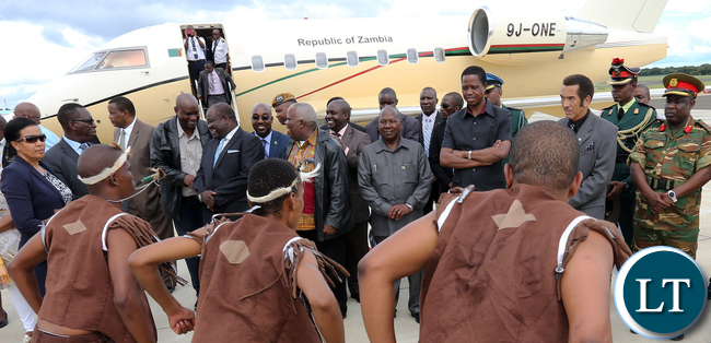President Edgar Lungu with Botswana President Gen Dr Ian Khama watching traditional dancers at Kasane international airport in Botswana on Monday