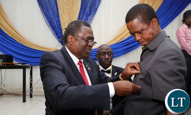 William Nyirenda from Rotary Pins a Honorary Membership of Rotary on President Edgar Lungu at Mansa Teja Hotel