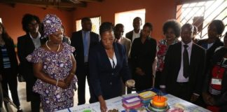First Lady Esther Lungu flanked by Misissi Outreach Health Centre Nutritionist Lina Sianzele(r) tours some stands during the hand over of food hampers to beneficiaries of Misissi Health Outreach Center at St.Lawrence Parish in Kamwala South.